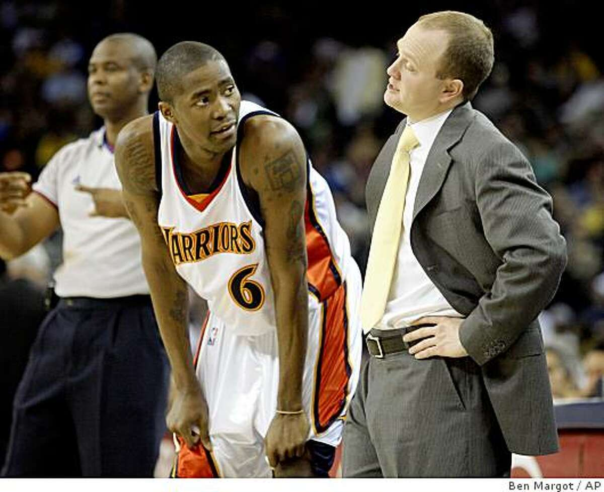New Jersey Nets coach Lawrence Frank, right, speaks with Golden State Warriors' Jamal Crawford during a break in the first half of an NBA basketball game Wednesday, March 11, 2009, in Oakland, Calif. (AP Photo/Ben Margot)