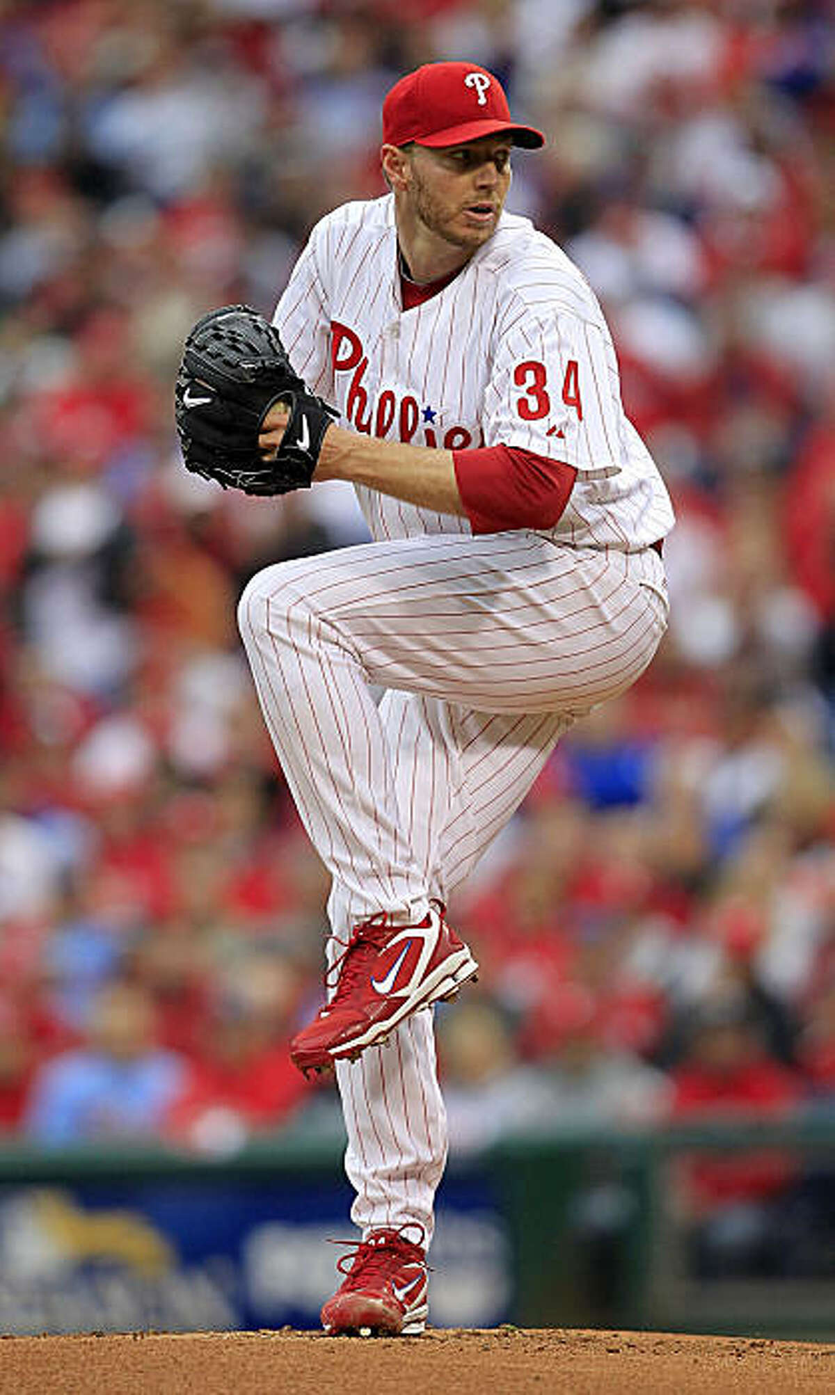 PHILADELPHIA - OCTOBER 06: Roy Halladay #34 of the Philadelphia Phillies delivers in Game 1 of the NLDS against the Cincinnati Reds at Citizens Bank Park on October 6, 2010 in Philadelphia, Pennsylvania. (Photo by Chris Trotman/Getty Images) *** Local Caption *** Roy Halladay