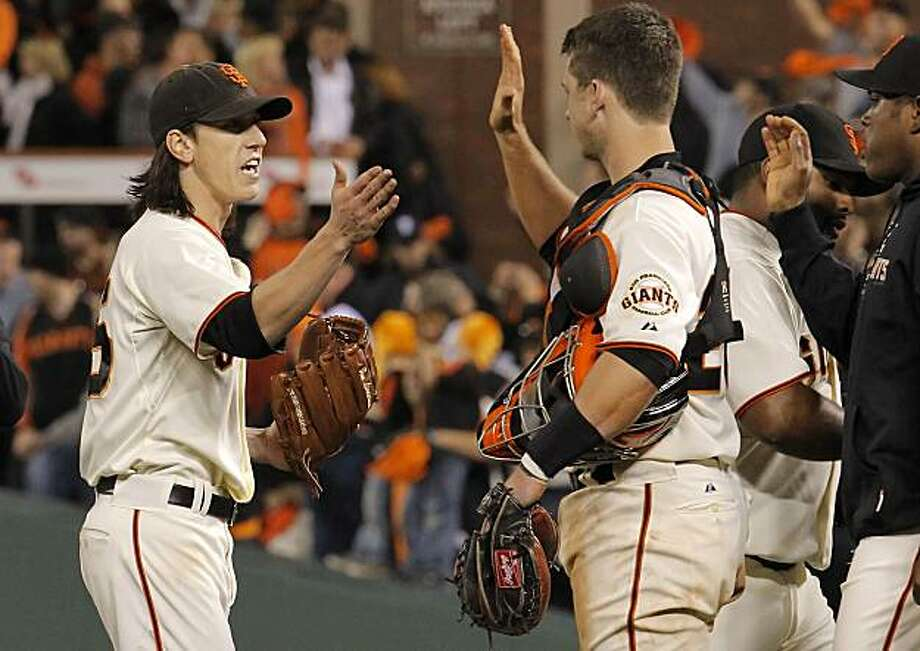 Giants starting pitcher Tim Lincecum, (left) closes out the 9th inning and celebrates with catcher, Buster Posey and other teammates, he finished with a total of 14 strikeouts during game one of the National League Division Series between the San Francisco Giants and Atlanta Braves which the Giants won 1-0, at AT&T Park in San Francisco, Calif., on Thursday Oct. 7, 2010. Photo: Michael Macor, The Chronicle