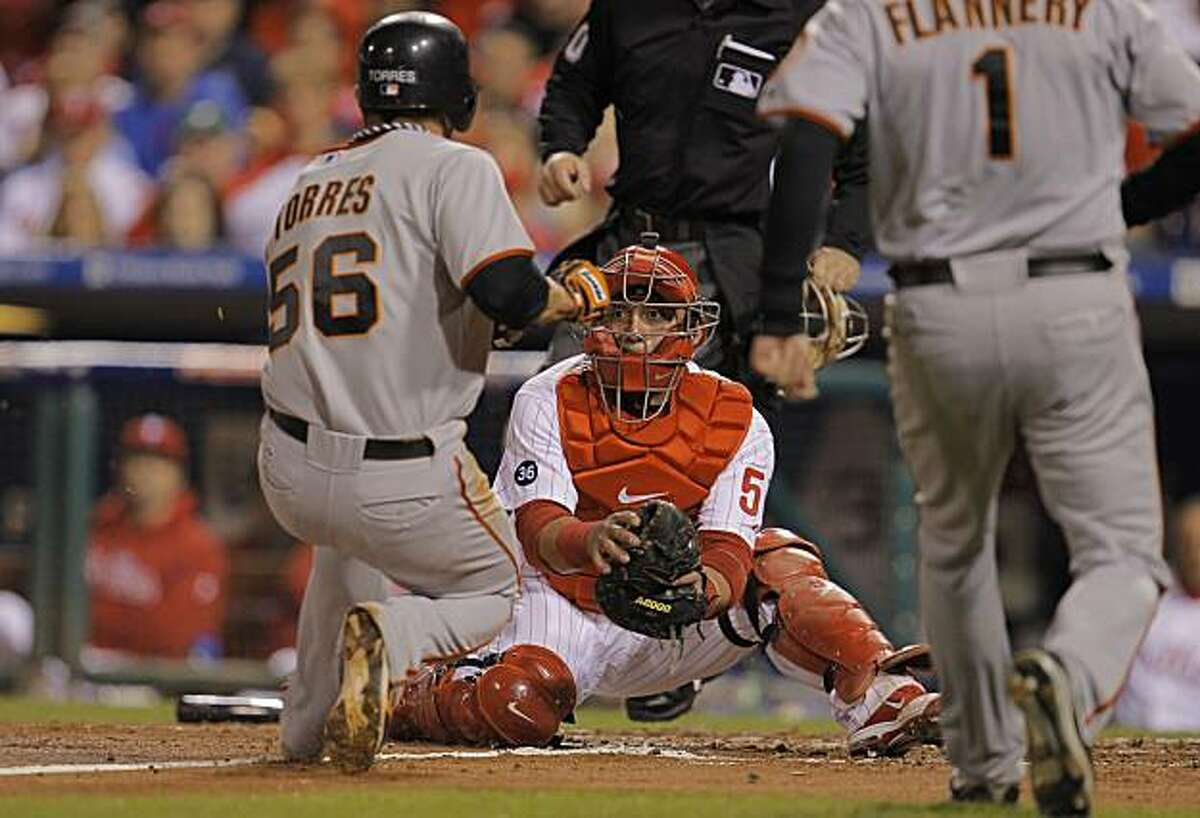 The Giants' Andres Torres is out at home trying to score, waiting is Phillies catcher Carlos Ruiz in Game 6 of the NLCS on Saturday at Citizens Bank Park in Philadelphia.