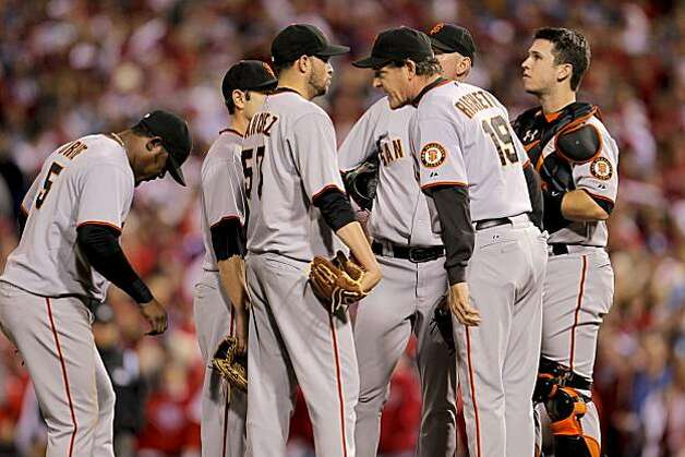 Giants pitching coach Dave Righetti visits the mound as Jonathan Sanchez gives up two runs in the first inning against the Phillies in Game 6 of the NLCS on Saturday at Citizens Bank Park in Philadelphia. Photo: Michael Macor, The Chronicle