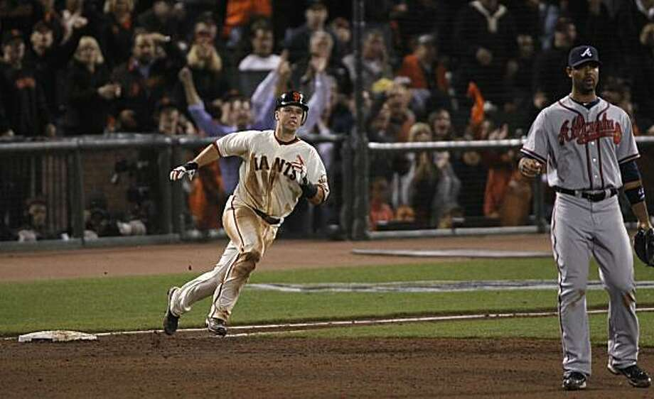 Buster Posey rounds first base on his double to center field in the 4th inning as the San Francisco Giants take on the Atlanta Braves  in Game 1 of the National League Division Series at AT&T Park in San Francisco, Calif., on Thursday, October 7, 2010. Photo: Paul Chinn, The Chronicle