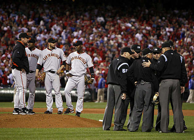 Giants, Jonathan Sanchez center, waits on the mound as the umpires discuss the bench clearing scuffle between the Giants and the Phillies after Sanchez exchanged words with Phillies 2nd baseman Chase Utley who Sanchez hit in the 4th inning during sixth game of the National League Championship Series, Saturday Oct. 23, 2010 at Citizens Bank Park in Philadelphia PA. Photo: Lance Iversen, The Chronicle