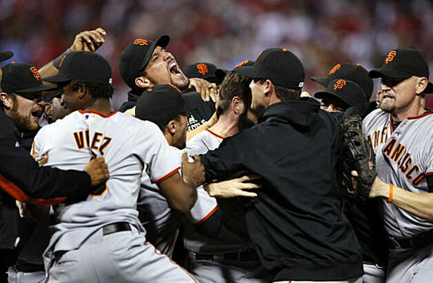 San Francisco Giants rush the mound in celebration after their victory over the Philadelphia Phillies 3-2 in game six of the National League Championship Series, Saturday Oct. 23, 2010 at Citizens Bank Park in Philadelphia PA. Photo: Lance Iversen, The Chronicle