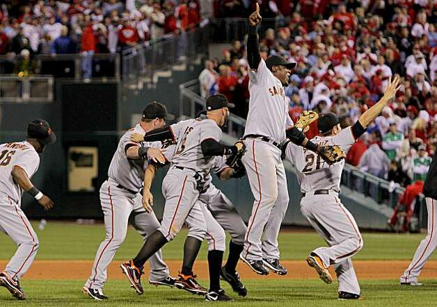 The Giants celebrate their victory, with Juan Uribe in the center, after beating the Phillies 3-2 in Game 6 of the NLCS on Saturday at Citizens Bank Park in Philadelphia. Photo: Michael Macor, The Chronicle