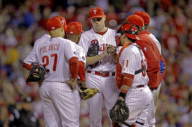 Phillies pitcher Ryan Madison gets a visit to the mound in the eighth inning of Game 6 of the NLCS on Saturday at Citizens Bank Park in Philadelphia. Photo: Michael Macor, The Chronicle