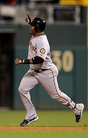 The Giants' Juan Uribe rounds the bases after his eighth inning home run in Game 6 of the NLCS on Saturday at Citizens Bank Park in Philadelphia. Photo: Michael Macor, The Chronicle