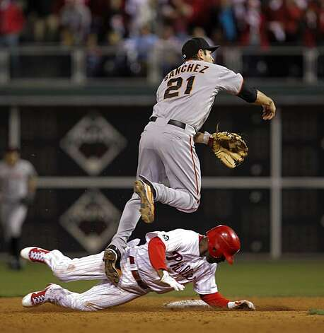The Giants' Freddy Sanchez forces the Phillies' Jimmy Rollins at second base but does not complete the double play in the ninth inning of Game 6 of the NLCS on Saturday at Citizens Bank Park in Philadelphia. Photo: Michael Macor, The Chronicle