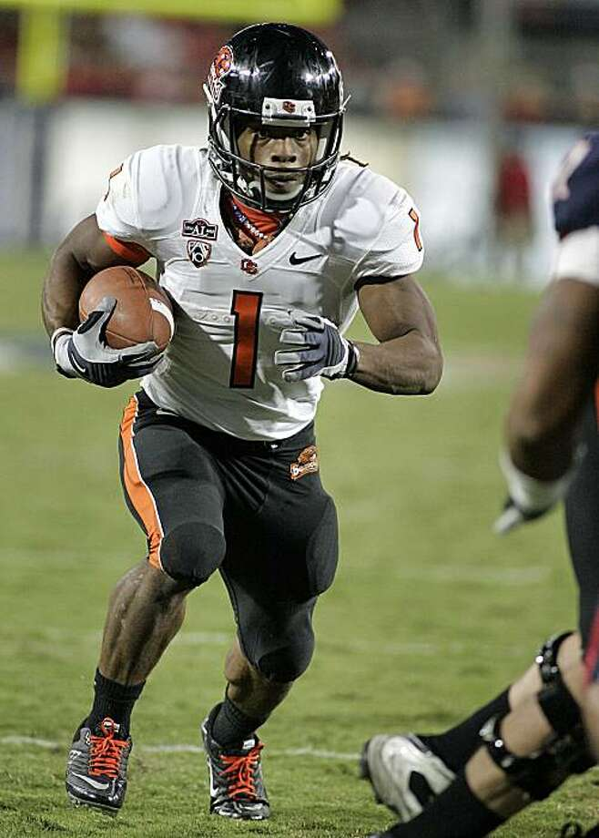 Oregon States' Jacquizz Roders (1) runs up the middle against Arizona during the second half of an NCAA college football game at Arizona Stadium  in Tucson, Ariz., Saturday, Oct. 9, 2010. Oregon State won 29 - 27. Photo: John Miller, AP