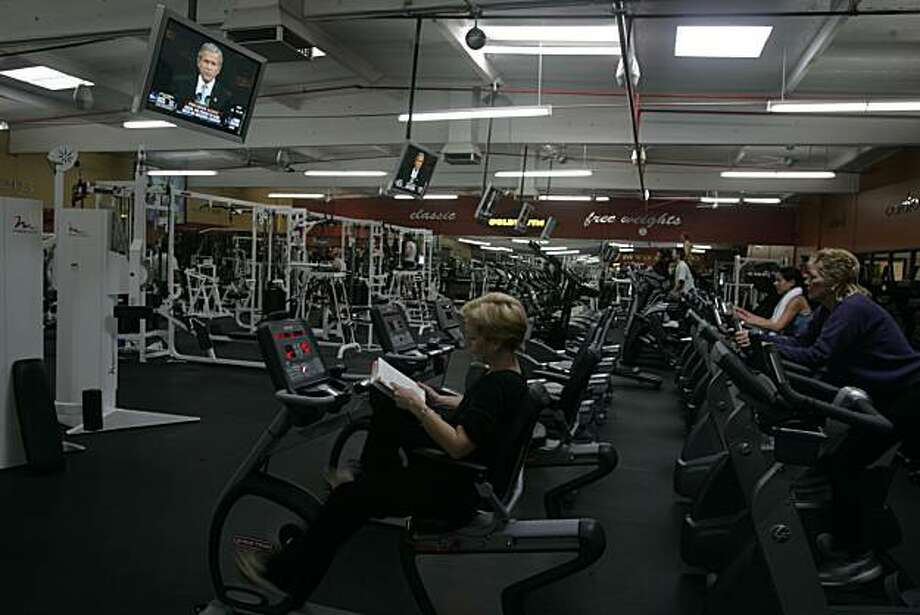 Missy Reynolds, Mill Valley, working out at Gold's Gym in Corte Madera during President Bush's  victory speech. Event on 11/4/04 in Corte Madera. Photo: Eric Luse, The Chronicle