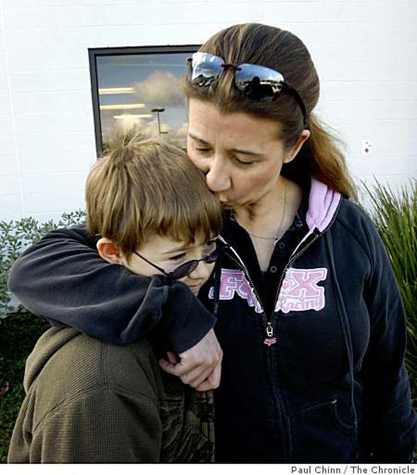 Laura DeVoe and her son Devin, 11, get ready to leave after loading their car with groceries from the Bishop's Storehouse in Concord, Calif., on Wednesday, Feb. 25, 2009. Operated by the Latter-Day Saints, the storehouse provides food and provisions to church members in need.