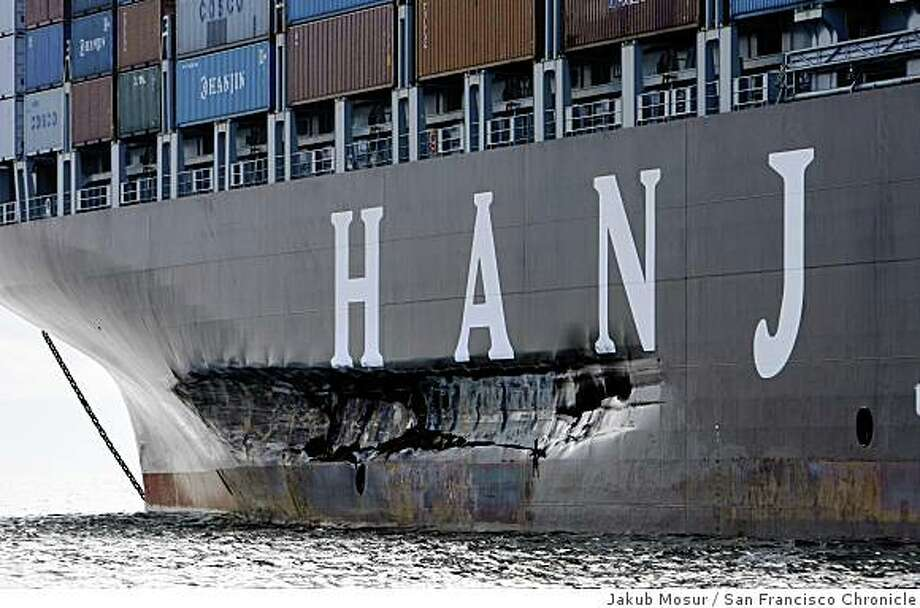 Cosco Busan sits south of the Bay Bridge two days after it had struck a Bay Bridge tower near Yerba Buena Island on Wednsday, Nov. 7, 2007 spilling 58,000 gallons of fuel into San Francisco Bay. Jakub Mosur / The Chronicle Photo: Jakub Mosur, San Francisco Chronicle