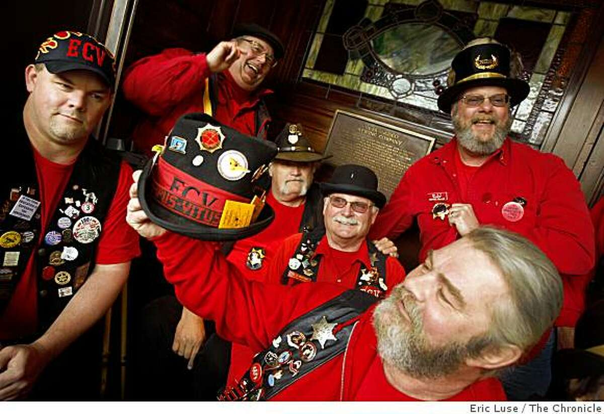 """Gary """"Hangman"""" Kammerer proudly shows hit ECV hat in front of the plaque at the San Francisco Brewing Company place by the San Francisco Chapter of E Clampus Vitus. They've placed plaques around the city which commemorates the history photographed on Monday, February 16, 2009."""
