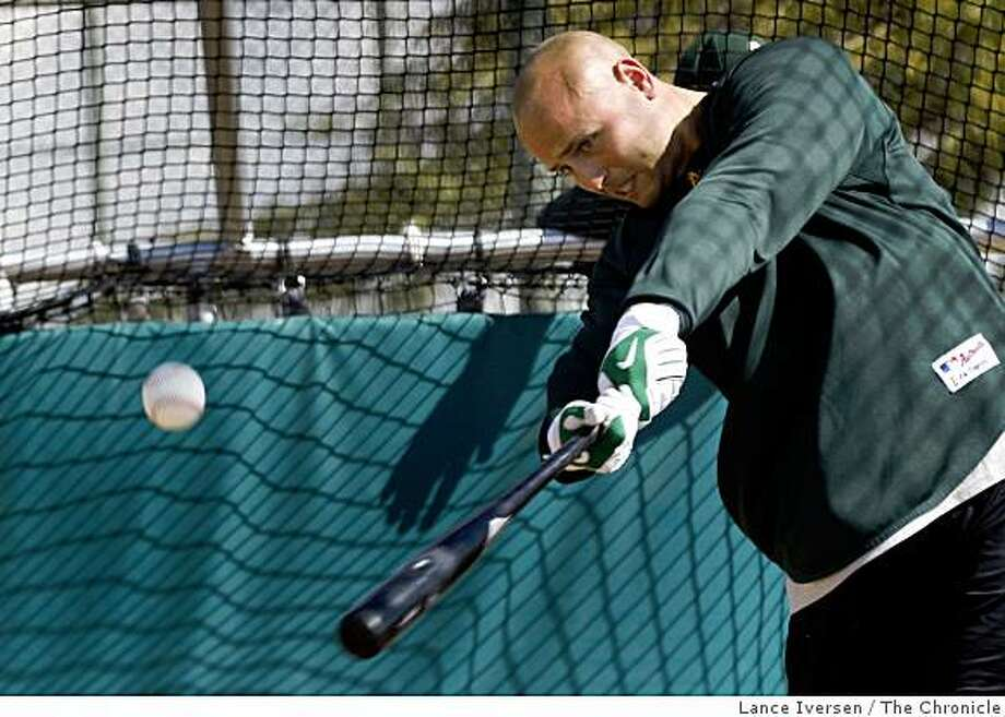 Oakland Athletics outfielder Matt Holliday takes batting practice with teammates during Spring Training workouts at the Papago Baseball Complex Tuesday February 17, 2009 in Phoenix Arizona Photo: Lance Iversen, The Chronicle