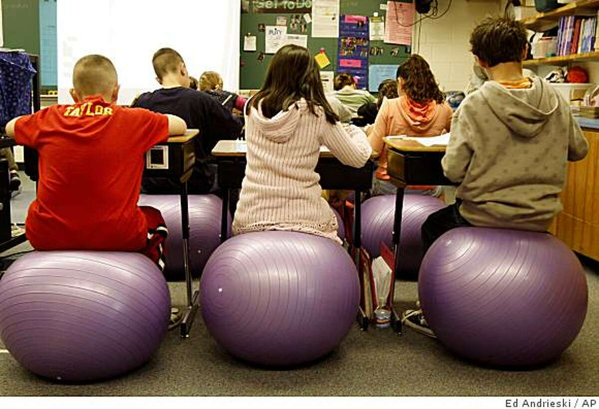 **APN ADVANCE FOR MARCH 8** The fourth grade class at Bauder Elementary School sit on stability balls instead of chairs in Fort Collins, Colo., on Tuesday, Feb. 24, 2009. (AP Photo/Ed Andrieski)