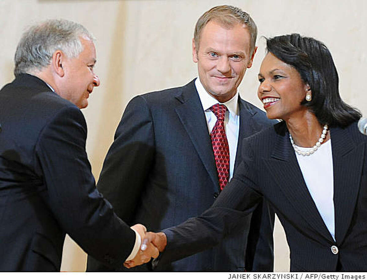In this file photo, U.S. Secretary of State Condoleezza Rice (R) shake hands with Polish President Lech Kaczynski next to Polish Prime Minister Donal Tusk after signing a deal on basing an American missile shield in Poland, August 20, 2008 in Warsaw.