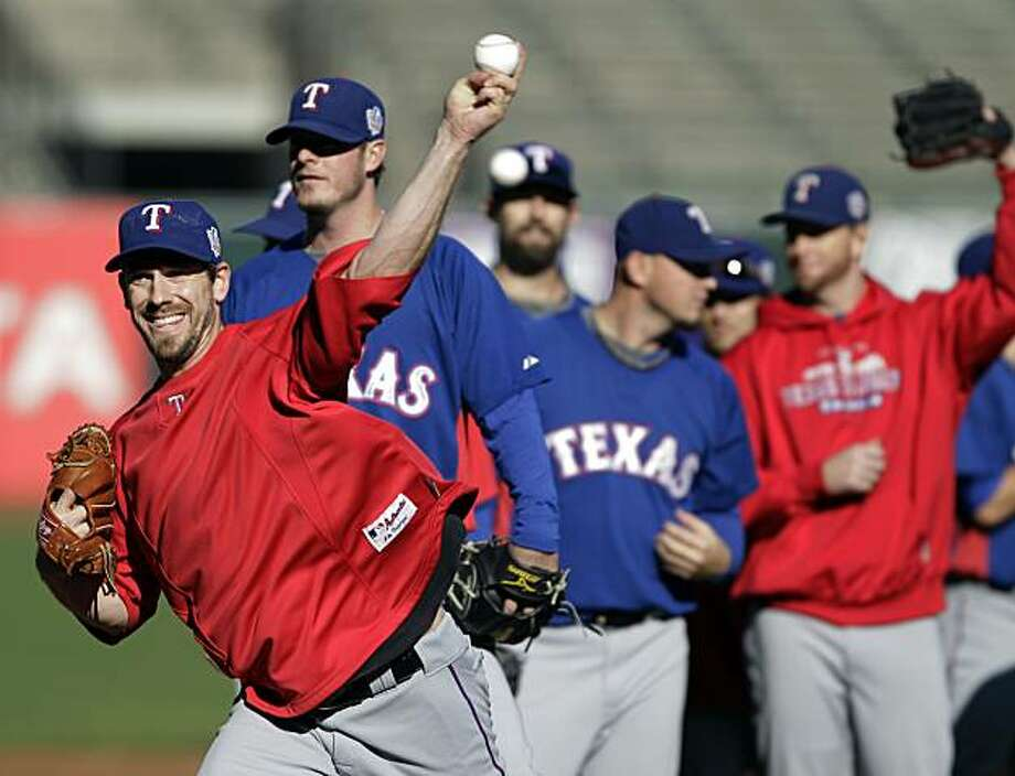 Texas Rangers' Cliff Lee throws during practice for Game 1 of baseball's World Series against the San Francisco Giants Tuesday, Oct. 26, 2010, in San Francisco. Photo: Eric Risberg, AP