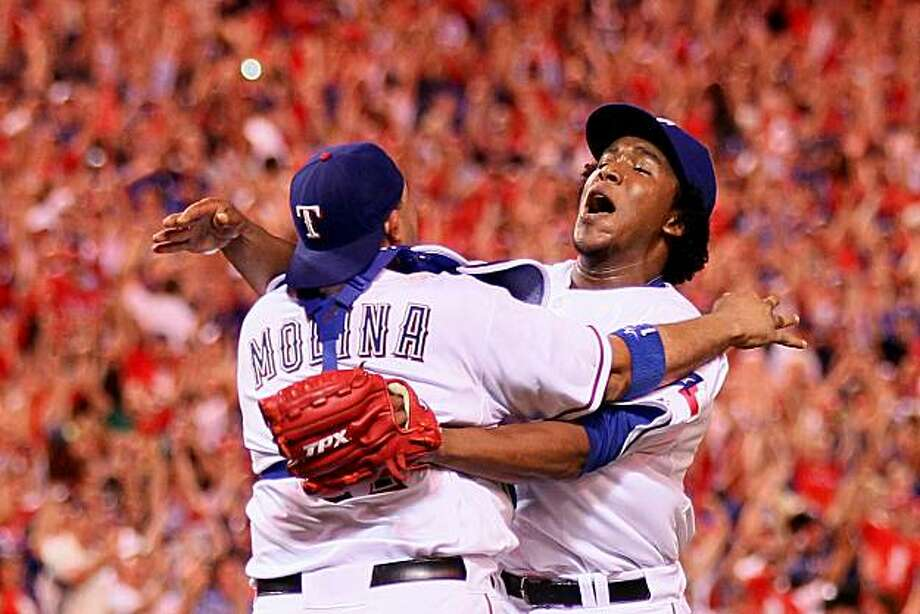 ARLINGTON, TX - OCTOBER 22:  Bengie Molina #11 and Neftali Feliz #30 of the Texas Rangers celebrate after defeating the New York Yankees 6-1 in Game Six of the ALCS to advance to the World Series during the 2010 MLB Playoffs at Rangers Ballpark in Arlington on October 22, 2010 in Arlington, Texas. Photo: Elsa, Getty Images