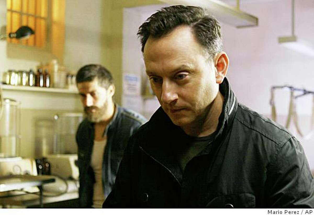 """In this image released by ABC, Matthew Fox, left, and Michael Emerson are shown in a scene from, """"Lost,"""" premiering Wednesday, Jan. 21, 2009."""