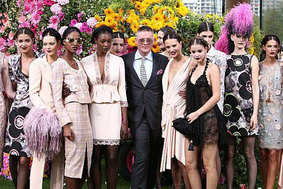 Giles Deacon (center) with models at Ungaro's spring/summer 2011 fashion presentation during Fashion Week. Photo: Courtesy Emanuel Ungaro