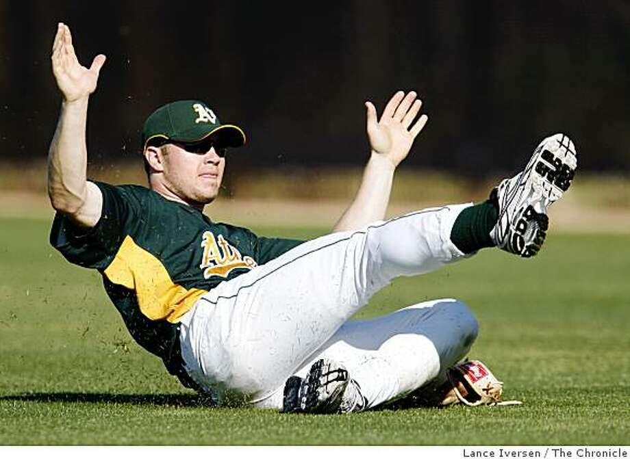 Oakland Athletics Ben Copeland practices his slide during Spring Training at Phoenix Municipal Stadium Tuesday February 24, 2009 in Phoenix. Photo: Lance Iversen, The Chronicle