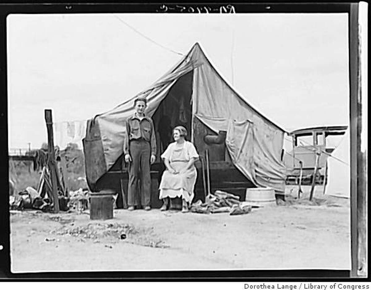 Part of migrant family of five encamped near Porterville, California, while waiting for work in the orange groves in Porterville, California circa Nov. 1936.