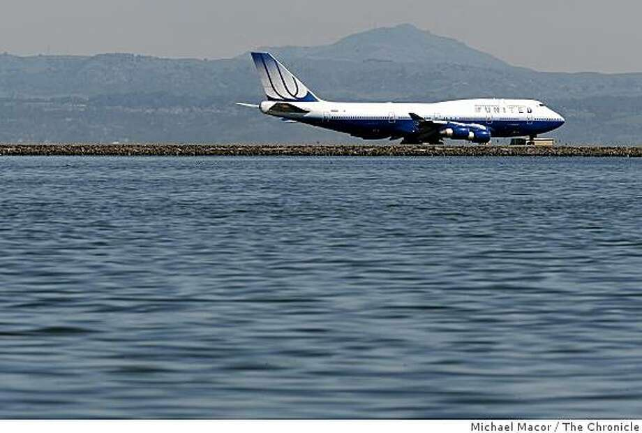 The runways at San Francisco International Airport  may well be under water by the end of this century as the ocean is expected to rise nearly five feet along California's coastline, according to a report to the state released on Wednesday Mar. 11, 2009. Photo: Michael Macor, The Chronicle