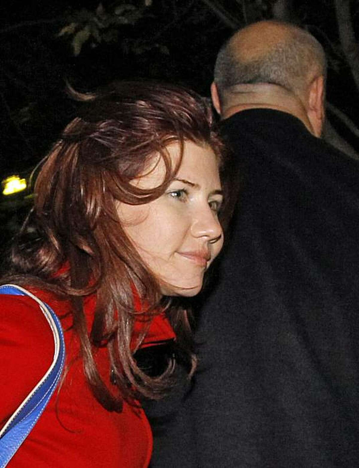 In this Thursday, Oct. 7, 2010 file photo, Anna Chapman, a Russian national who was deported from the U.S. this summer for alleged spying for Russia, is seen with an unidentified security man at the farewell ceremony for a U.S. astronaut and two Russian cosmonauts at Baikonur cosmodrome, Kazakhstan. President Dmitry Medvedev bestowed the country's highest state honor Monday Oct 18 2010 on the Russian sleeper agents deported from the United States as part of the countries' biggest spy swap since the Cold War, the Interfax news agency reported.