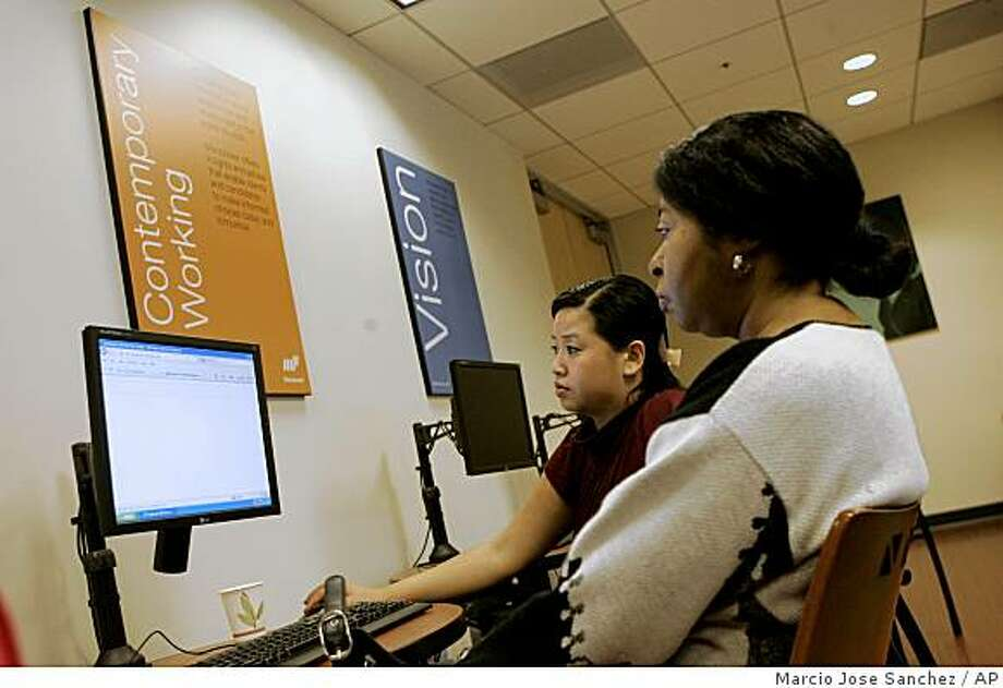 Staffing specialist Pratricia Tu, center, helps job seeker Linda Short with a database at Manpower, a private job placement firm, in San Francisco, Friday, March 6, 2009. The government says the nation's unemployment rate bolted to 8.1 percent in February, the highest since late 1983, as cost-cutting employers slashed 651,000 jobs. (AP Photo/Marcio Jose Sanchez) Photo: Marcio Jose Sanchez, AP