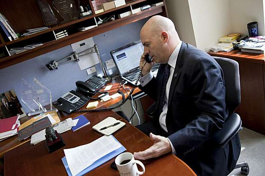 Clarke Cooper, an openly gay army reserve officer, is seen in his office in Washington, Thursday, Oct. 21, 2010.  Cooper is an unlikely activist who has beaten the military's Don't Ask, Don't Tell policy on every level. Despite being president of the gayrights organization that won the injunction against the controversial policy, he is also an army reserve officer who was never kicked out of the military for being openly gay. Photo: Evan Vucci, Associated Press