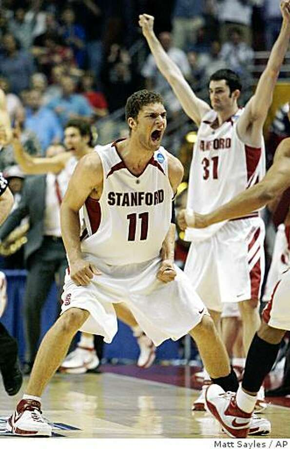 Stanford's Brook Lopez (11) and Taj Finger (31) celebrate after Stanford beat Marquette 82-81 in overtime during their second round basketball game at the NCAA South Regional on Saturday, March 22, 2008 in Anaheim, Calif. Lopez scored the game-winning basket with 1.3 seconds left in the game. (AP Photo/Matt Sayles) Photo: Matt Sayles, AP