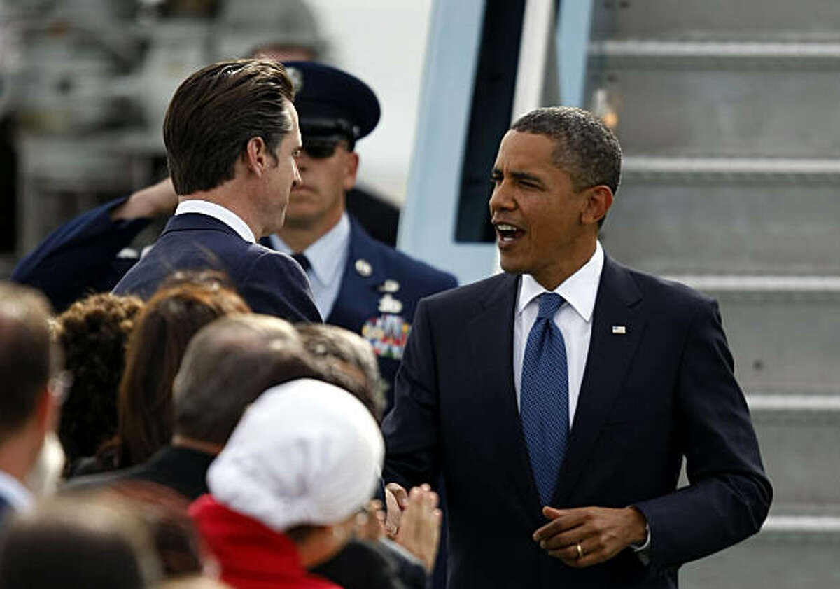 Mayor Gavin Newsom shakes hands with President Barack Obama as he arrives at San Francisco International Airport Wednesday, October 21, 2010, in San Francisco, Calif. Obama is campaigning to raise money for Democrats on a five-state and four-day trip.