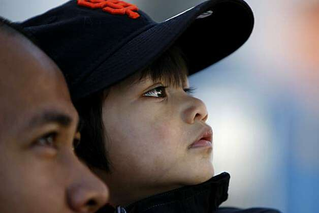 Oscar Montemayor holds his son Ethan, 2yr. outside the Giants ball park, Monday Oct. 25, 2010, in San Francisco, Calif. They plan on watching the game for a little while along the fence and then going home to watch it on television. Photo: Lacy Atkins, The Chronicle