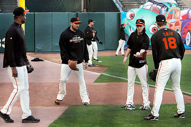 Giants pitchers, l-r, Guillermo Mota, Jonathan Sanchez, Tim Lincecum, and Matt Cain play a game of catch during practice. The San Francisco Giants held their first team practice at AT&T Park in San Francisco, Calif., on Monday, October 25, 2010, following their NLCS win over the weekend. The team is now preparing for the World Series which opens at AT&T Park on Wednesday. Photo: Carlos Avila Gonzalez, The Chronicle