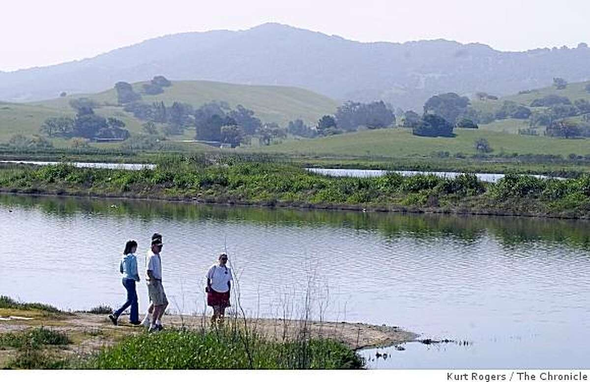 """Hikers walk down to the water at Shollenberger Park in Petaluma , part of March 5, 2009 """"best of urban outings"""" 96 hours section."""