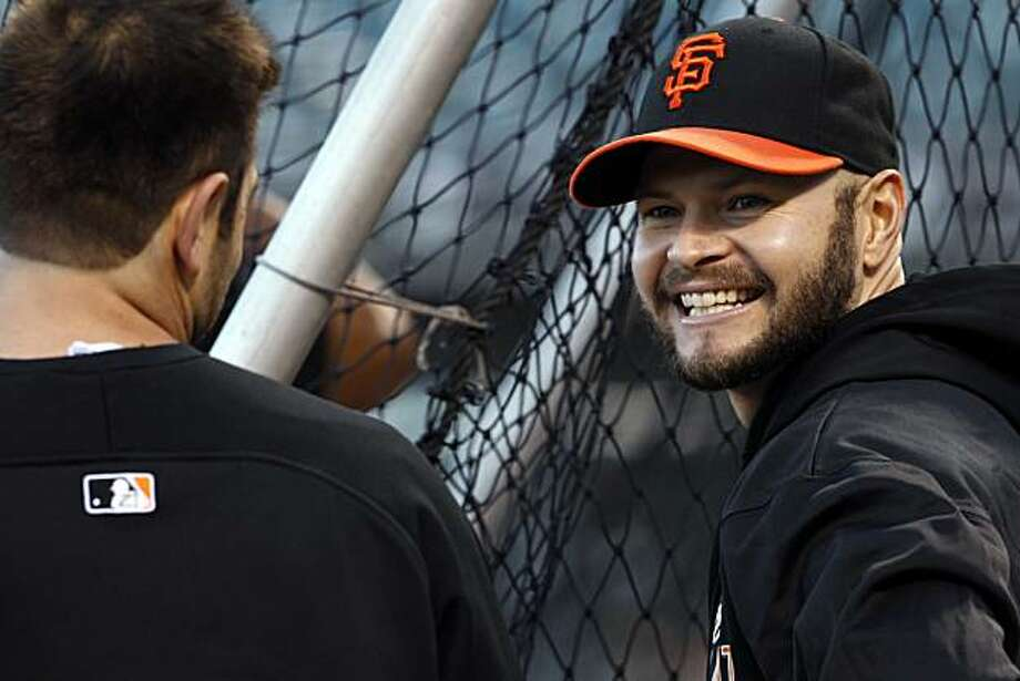 Cody Ross smiles at teammate, Freddy Sanchez during batting practice. The San Francisco Giants held their first team practice at AT&T Park in San Francisco, Calif., on Monday, October 25, 2010, following their NLCS win over the weekend. The team is now preparing for the World Series which opens at AT&T Park on Wednesday. Photo: Carlos Avila Gonzalez, The Chronicle