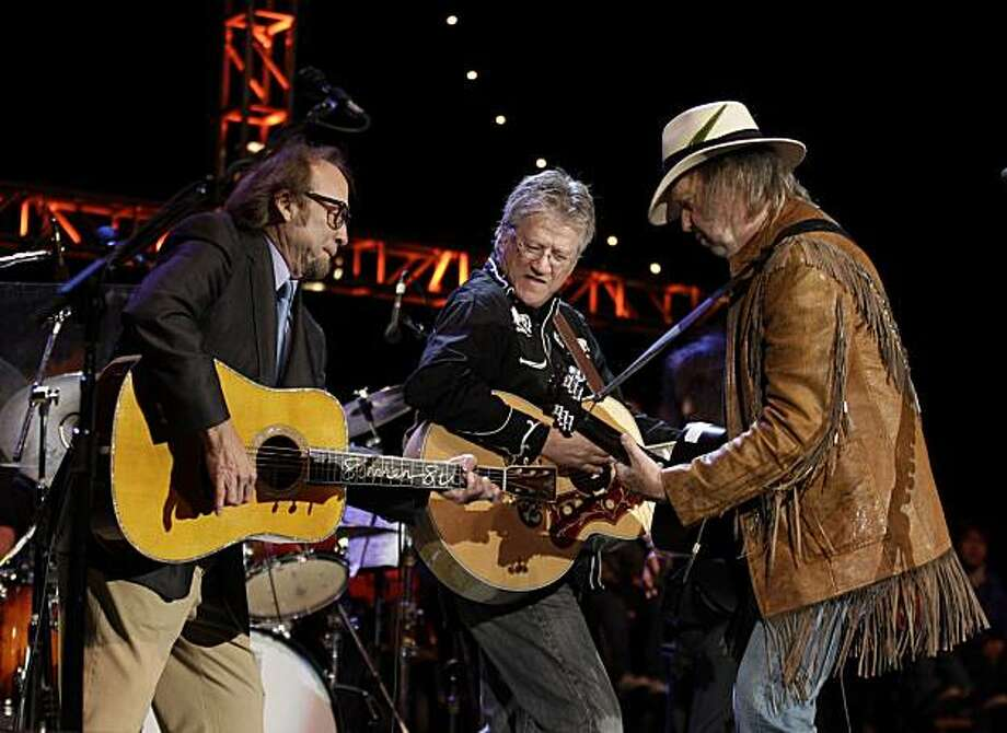 From left, Stephen Stills, Richie Furay and Neil Young of Buffalo Springfield perform together during the Bridge School Benefit concert in Mountain View, Calif., Saturday, Oct. 23, 2010. The group last played in public in 1968 at the Long Beach Arena. Theconcert benefits the Bridge School, which assists children with severe physical impairments and complex communication needs. Photo: Eric Risberg, AP