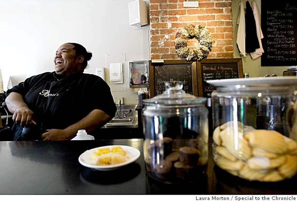 Barista Ohla Coleman shares a laugh with her co-workers while working at Bernies, a coffee shop located at 3966 24th St. in Noe Valley, in San Francisco, Calif., on Thursday, February 26, 2009.