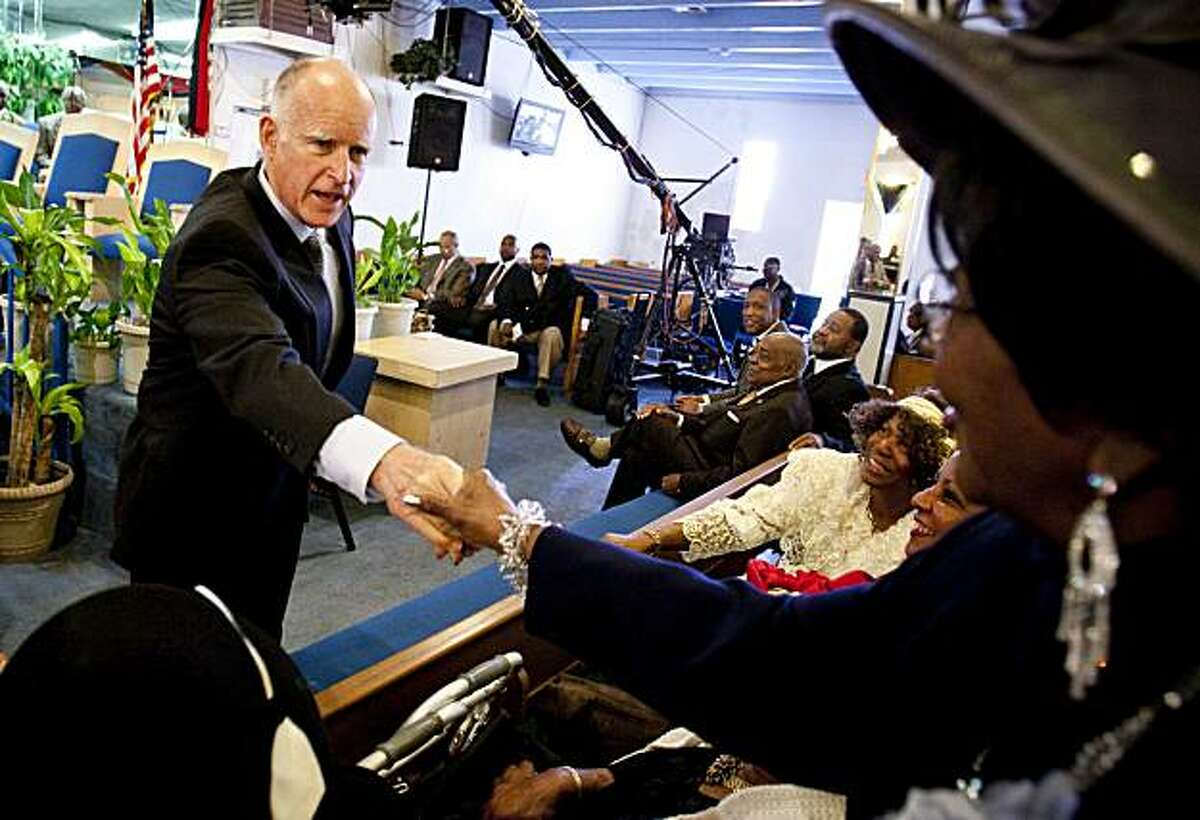 California Attorney General and Democratic gubernatorial candidate Jerry Brown greets supporters Sunday, Oct. 24, 2010, at the Little Zion Missionary Baptist Church in Compton, Calif. Brown was in Southern California on Sunday, meeting with church leadersand parishioners throughout Los Angeles in the morning and rallying with voters and volunteers in the San Fernando Valley in the afternoon.