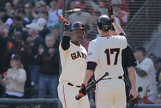 San Francisco Giants' Edgar Renteria (l to r) celebrates with Aubrey Huff after Renteria scored off a single RBI hit by Cody Ross in the fourth inning during Game 3 of the National League Championship Series against the Philadelphia Phillies at AT&T Park on Tuesday, October 19, 2010 in San Francisco, Calif. Huff also hit a single RBI in the fourth inning. Photo: Lacy Atkins, The Chronicle