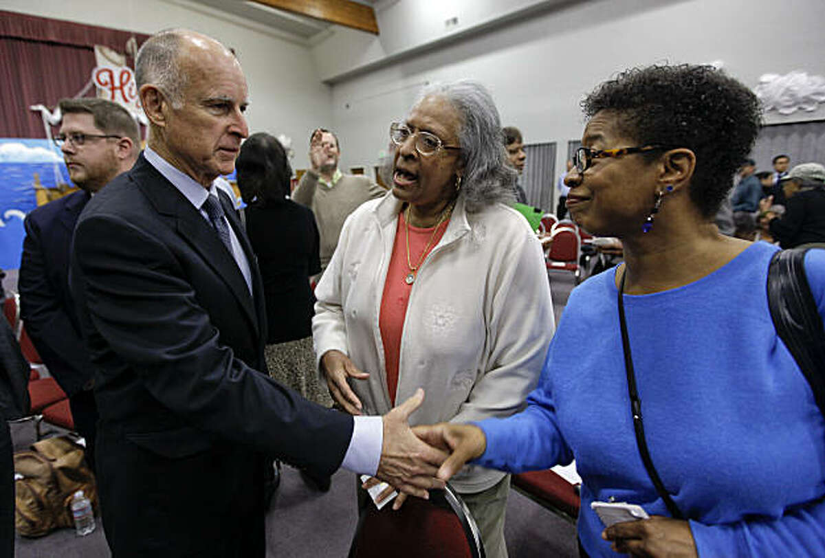 Gubernatorial candidate Jerry Brown meets with Ellen Turner, (center) and Rhonda Foston, of the San Francisco Christian Center, before his address to a group of voters at the Faith Forum in San Francisco, Ca. on Saturday July 31, 2010.