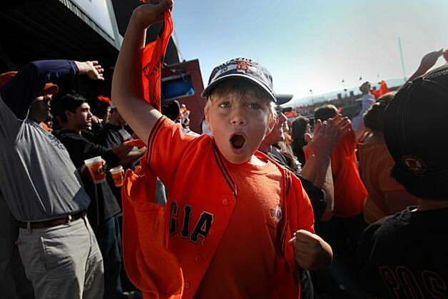 Lucas Peters, 9, of Novato, waves his rally after in the 7th during game 3 of the National League Champion series with the San Francisco Giants and the Philadelphia Phillies on Tuesday Nov. 19, 2010 in San Francisco, Calif.  Giants won with a final score of 3-0. Photo: Mike Kepka, The Chronicle