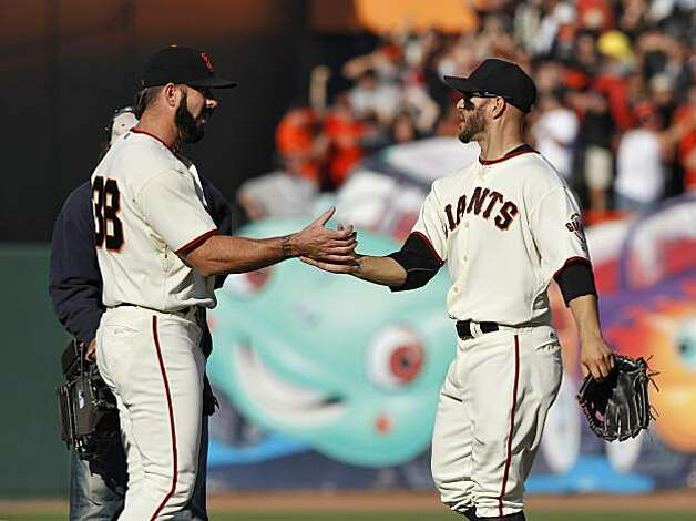 Cody Ross shakes hands with Brian Wilson as the Giants celebrate their win on the field. The San Francisco Giants played the Philadelphia Phillies at AT&T Park in San Francisco, Calif., on Tuesday, October 19, 2010, in Game 3 of the National League Championship Series. The Giants defeated the Phillies 3-0. Photo: Carlos Avila Gonzalez, The Chronicle