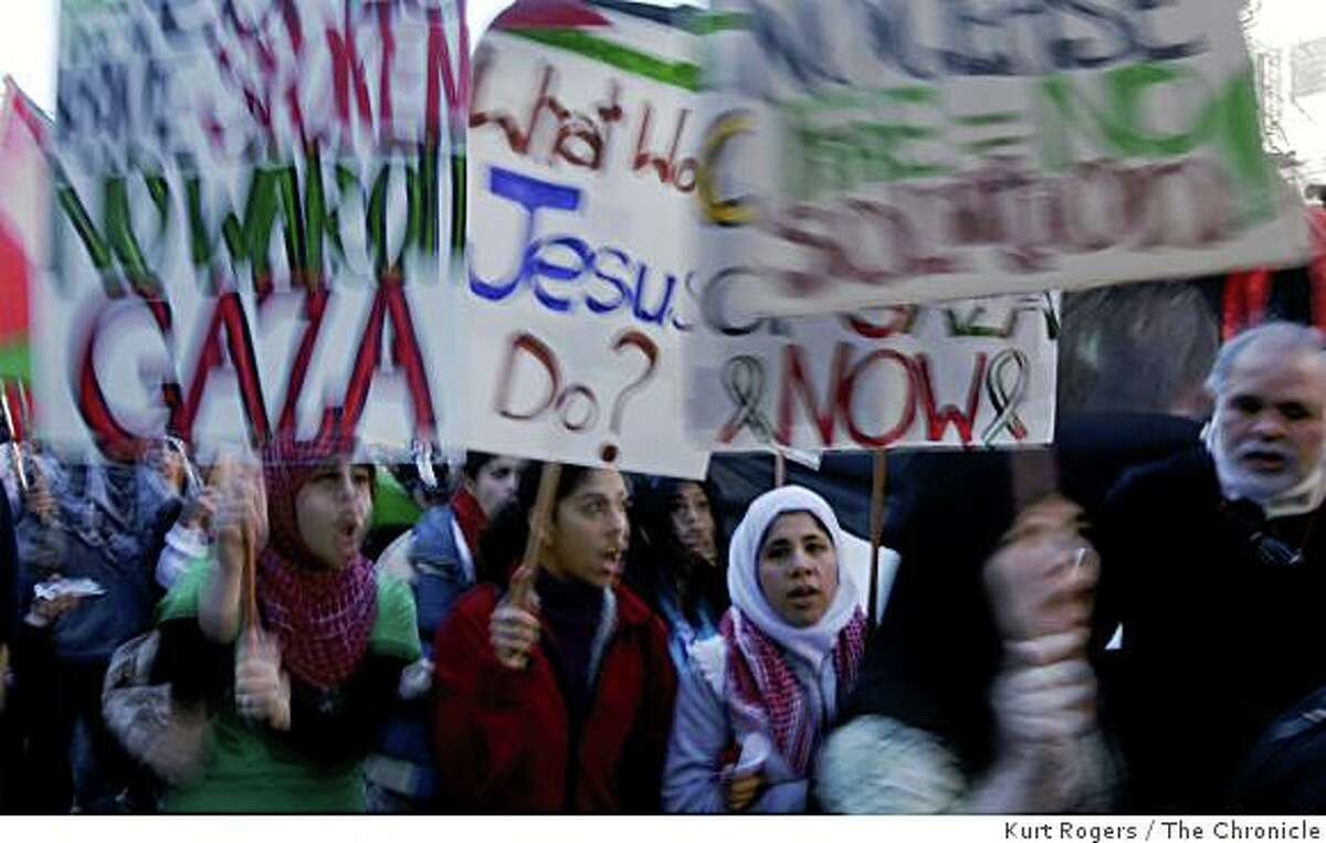 Pro-Palestinian demonstrators carrying signs march throughout The City on Saturday, Jan. 10, 2009 in San Francisco, Calif.