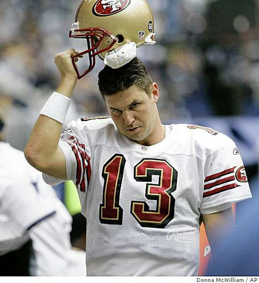 San Francisco 49ers quarterback Shaun Hill (13) puts his helmet on as the game ended with a 35-22 loss to the Dallas Cowboys in an NFL football game, Sunday, Nov. 23, 2008, in Irving, Texas. (AP Photo/Donna McWilliam) Photo: Donna McWilliam, AP