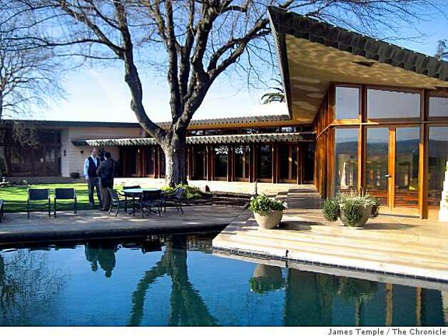 The backyard pool and south wing of a home designed by Frank Lloyd Wright in 1955 were completed in 1961 at  21200 Center Ave. in Los Banos, Calif. Photo: James Temple, The Chronicle