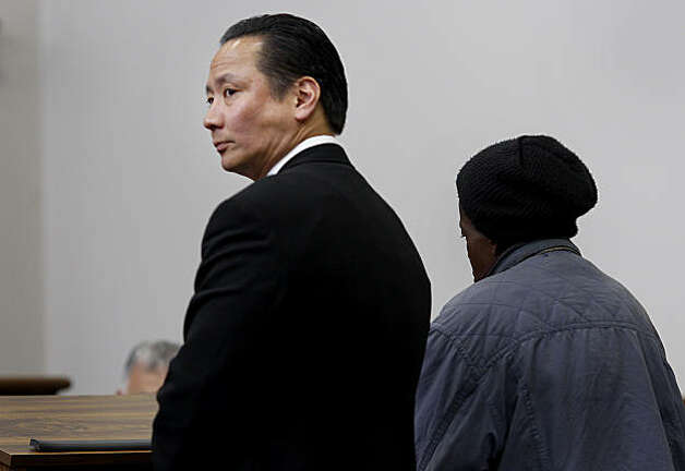 Public Defender Jeff Adachi (left) stood with a homeless woman  before Judge Ron Albers. San Francisco Public Defender Jeff Adachi is representing defendants at the new Community Justice Center Tuesday March 10, 2009. Photo: Brant Ward, The Chronicle