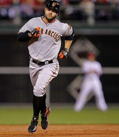 Giants Cody Ross rounds the bases after his solo home run in the third inning, as the San Francisco Giants went on the beat the Philadelphia Phillies 4-3 in game 1 of the National League Championship Series, on Saturday Oct. 16, 2010 at Citizens Bank Park, in Philadelphia, Pa. Photo: Michael Macor, The Chronicle