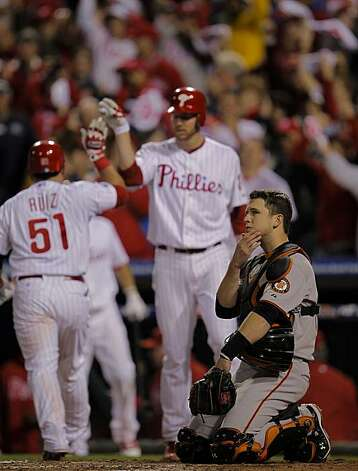 Giants catcher Buster Posey watches the Phillies' Carlos Ruiz hit a solo home run in the third inning of Game 1 of the National League Championship Series on Saturday at Citizens Bank Park in Philadelphia. Photo: Michael Macor, The Chronicle