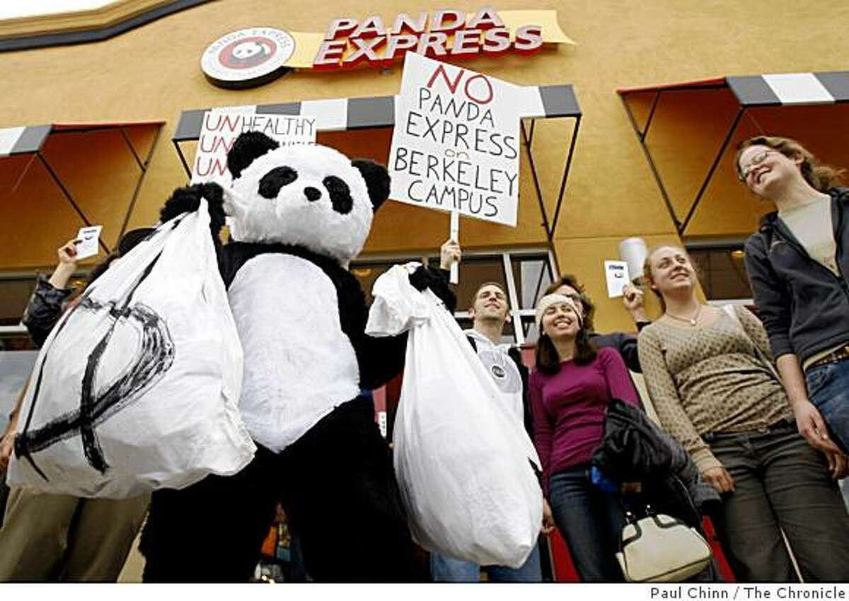 Byron Mazire wears a panda costume during a demonstration by UC Berkeley students in front of the Panda Express restaurant in El Cerrito, Calif., on Saturday, Feb. 28, 2009. The students are protesting the restaurant chain's plan to open a location on campus.